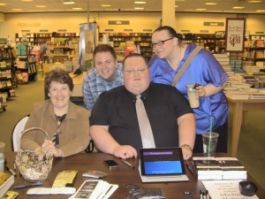 Michael Helgens, science fiction author, seated by me, and Bethany and Andy - two new friends!