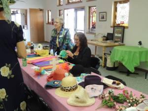 Karen Bowen, seated, and Maizel Dunn, standing, led the craft-making activities.