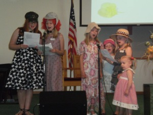 Girls singing in honor of mothers.