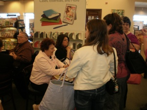 Mia, a new friend, and others wait to have their books signed by Mary
