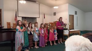 Girls presenting a Readers Theater of women in the Bible who loved and followed the Lord.