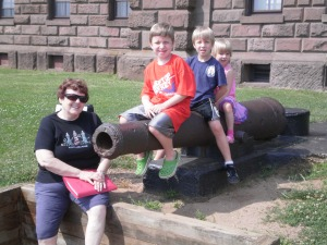 Grandkids on a canon found at the lighthouse in New Jersey
