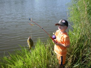 Grandson Hayden catching his first fish!