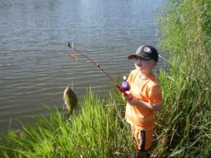 Grandson Hayden catching his first fish!