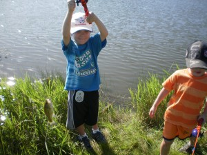 Zach's second catch of the day with Grandpa!