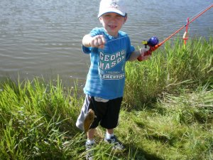 Grandson Zachary catching his first fish!