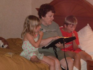 Gramma Mary sharing devotions with grandchildren on vacation